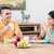 indian couple having breakfast in the kitchen stock photo © kzenon