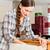 Young woman is assembling a cupboard stock photo © Kzenon