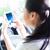 vrouw · rijden · auto · typen · mobiele - stockfoto © kzenon
