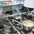 pots and pans on stove in restaurant kitchen the chef working i stock photo © kzenon