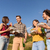 friends at bbq party in nature drinking beer and eating burgers stock photo © kzenon