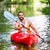 man driving with kayak on forest river stock photo © kzenon