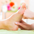 woman in nail salon receiving foot massage stock photo © kzenon
