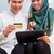 asian muslim couple shopping online on pad in living room stock photo © kzenon