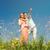 Happy family standing on meadow in summer stock photo © Kzenon