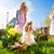 children on easter egg hunt with bunny stock photo © kzenon