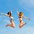 two happy women jumping high with fun stock photo © kzenon