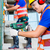 Asian construction workers drilling in building walls stock photo © Kzenon