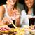 two women eating hamburger and drinking soda stock photo © kzenon