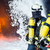 firefighter   firemen extinguishing a large blaze stock photo © kzenon