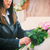 woman putting rose on coffin at funeral stock photo © kzenon