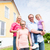 family standing in front of home or house stock photo © kzenon