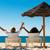 heureux · couple · plage · séance · soleil · chaises - photo stock © Kzenon