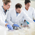 group of scientists in food laboratory with samples in petri dis stock photo © kzenon