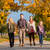 family having walk in front of colorful trees in autumn stock photo © kzenon