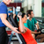 woman and personal trainer in gym with dumbbells stock photo © kzenon