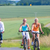 family having weekend bicycle tour outdoors stock photo © kzenon