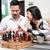 hombre · jugando · ajedrez · tablero · de · ajedrez · pensando · estrategia - foto stock © kzenon