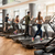 group of four people running on treadmills in fitness gym stock photo © kzenon