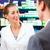 Female pharmacist consulting a customer in pharmacy stock photo © Kzenon