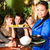 young people with waitress eating in thai restaurant stock photo © kzenon