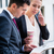 business man and woman with paper and phone stock photo © kzenon