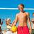 friends playing beach volleyball stock photo © kzenon