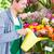 florist working in flower shop watering plants stock photo © kzenon