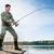 pescador · peixe · lago · blue · sky · água · pescaria - foto stock © kzenon