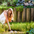 woman sitting at pond in her garden stock photo © kzenon