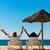 gelukkig · paar · strand · vergadering · zon · stoelen - stockfoto © Kzenon