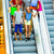 family in shopping mall on escalators with bags stock photo © kzenon