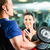 Personal Trainer in gym and dumbbell training stock photo © Kzenon