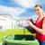 woman emtying trash or garbage into litter box stock photo © kzenon
