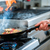 chef doing flambe to food in pan with alcohol stock photo © kzenon