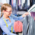 cleaner in laundry shop checking clean clothes stock photo © kzenon