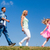 family walks on meadow daughter leads parents follow stock photo © kzenon