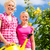 family at gardening in front of rose bushes stock photo © kzenon