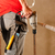 bouwvakker · hand · boor · permanente · man · bouw - stockfoto © Kzenon