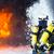 firefighter   firemen extinguishing a large blaze stock photo © kzenon