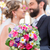 bridal couple in church with flower bouquet stock photo © kzenon