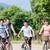 family of four on bike tour in summer stock photo © kzenon