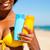 woman with suncream at the beach stock photo © kzenon