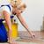 female tiler tiling tiles on the floor stock photo © kzenon