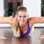 woman doing push ups in gym stock photo © kzenon