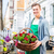 Florist with flower basket at shop selling stock photo © Kzenon
