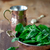 fresh spinach leaves in a beautiful copper bowl stock photo © laciatek