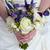 menyasszony · esküvői · csokor · tart · kéz · pár · rózsák - stock fotó © leeavison