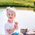 Cute little girl sitting near the lake stock photo © Len44ik