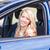 beautiful happy young girl sitting in the car stock photo © len44ik